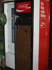 1973 Coke machine,  works great. Icy cold cokes at your finger tips